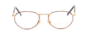 Metal frame in gold with brown patterned glass rim and black plated temples