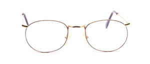 Thin-edged metal frame in gold with a subtly colorful patterned glass rim