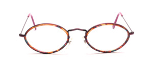 Oval metal frame with fine chiselling on the nose bridge and with an inner cell ring in brown with colorful inclusions