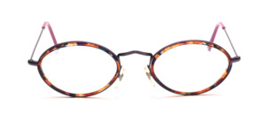 A high-quality, classic oval metal frame with brown inner cell rings, Made in Italy for K + B