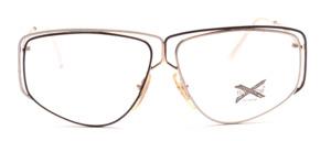 Große aussergewöhnliche Damenbrille in Gold mit Dekorelementen in Schwarz und Weiß