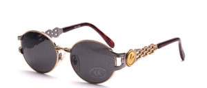 Luxurious oval metal sunglasses in design by Regina Schreckrer