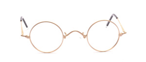 Round metal frame in matt gold with small glass size and flared jaws