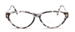 80er Jahre Cat Eye Damenbrille in Schwarz und Weiß gemustert mit goldenen Ziernieten