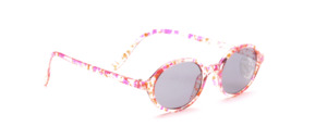 Ovale Kinder Sonnenbrille in Transparent mit Muster in in Pink und Orange