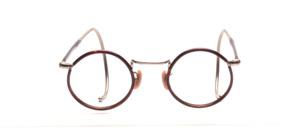 Kinderbrille aus den 1920er Jahren in Rund mit dunkelbraunem Windsorrand und halb überzogenen Gespinstbügeln in 145 mm Länge