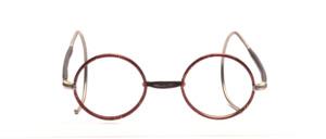 Runde Kinderbrille aus den 1930er Jahren in Silber mit dunkelbraunem Windsorrand und halb überzogenen Gespinstbügeln in 145 mm Länge