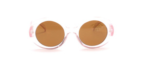 Almost round children's sunglasses in transparent pink with brown lenses
