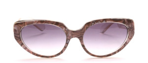 Butterfly sunglasses from the 80s in transparent with a mother-of-pearl gray patterned surface on the middle part