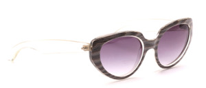 Butterfly sunglasses from the 80s in transparent with a brown patterned surface on the middle part