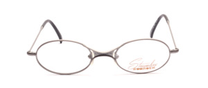 Oval metal frame in gray with a thin frame and distinctive nose bridge