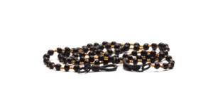 Pretty eyeglass chain made of black plastic beads with small gold pearls