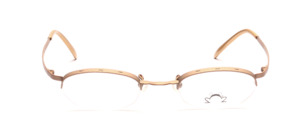 Distinctive half-rim glasses for women, in metallic gold, from the French designer forge